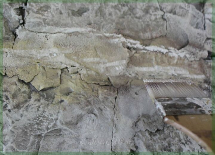 whitewashing a stone wall with diluted chalk paint