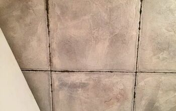 How do I remove vinyl tile adhesive that has leaked thru the seams?