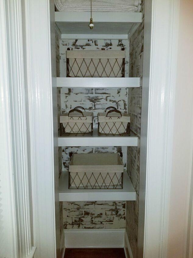Tiny closet repurposed into built in shelving