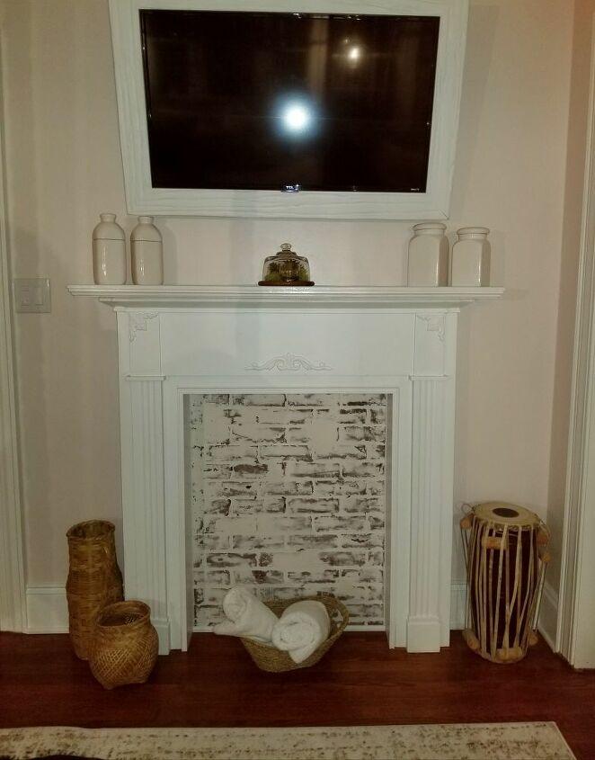 TV frame & fireplace surround w/ faux brick