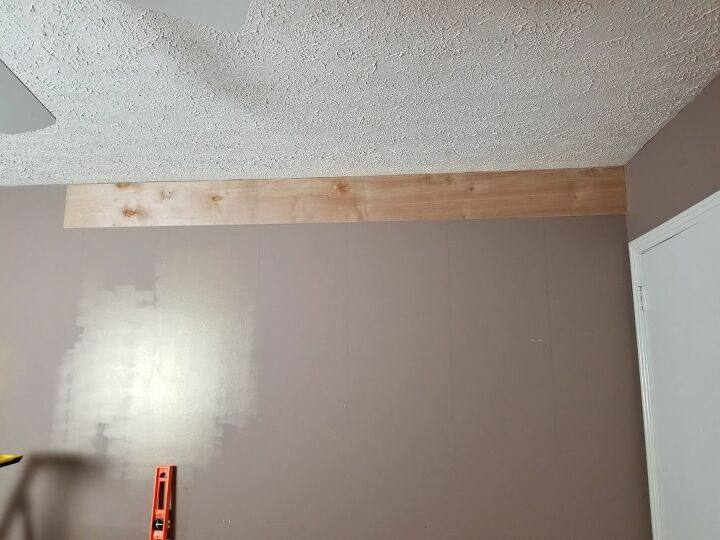 I started at the ceiling so the new baseboards could hide any gaps.