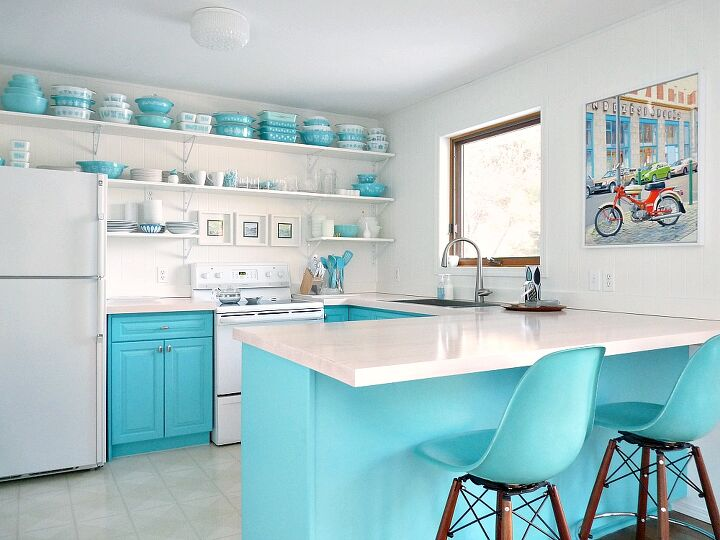s 26 upgrades for people who aren t afraid of color, As the heart of the home we re loving this turquoise in the kitchen