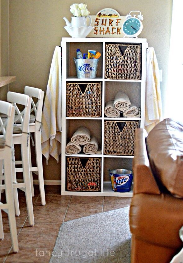 s 17 reasons why this wicker trend isn t going anywhere, Ikea Kallax Shelving as Surf Shack