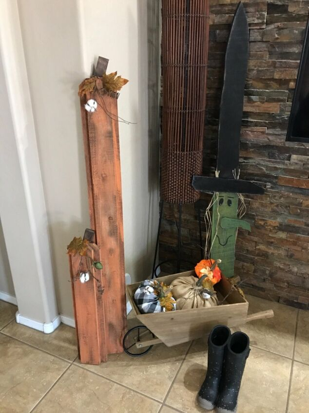 s 12 new fall porch decor ideas, Save those old fence boards for these adorable tall pumpkins