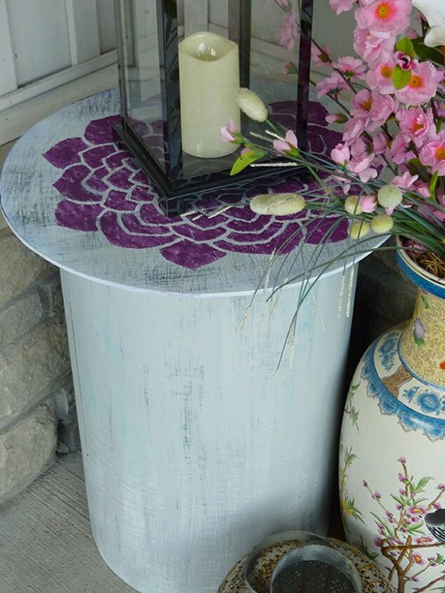 thrift store side table re purposed into a planter storage