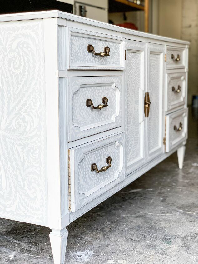 s 21 ways to redo that old dresser you can t stand looking at anymore, Hand painted detailing makes this dresser one of a kind