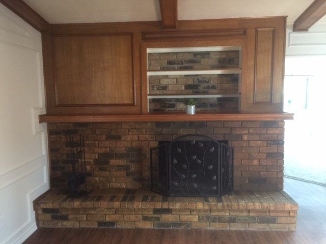 q how can i improve the looks of my fireplace