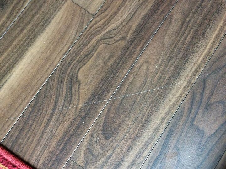 q i have a wood floating floor with a scratch how can i fix it so it i