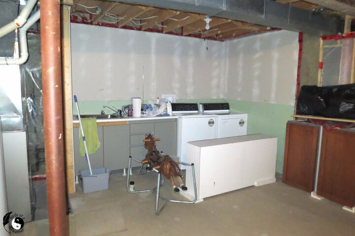 s 7 laundry room makeovers that ll make you want to do your laundry here, BEFORE This basement laundry room needed a fix