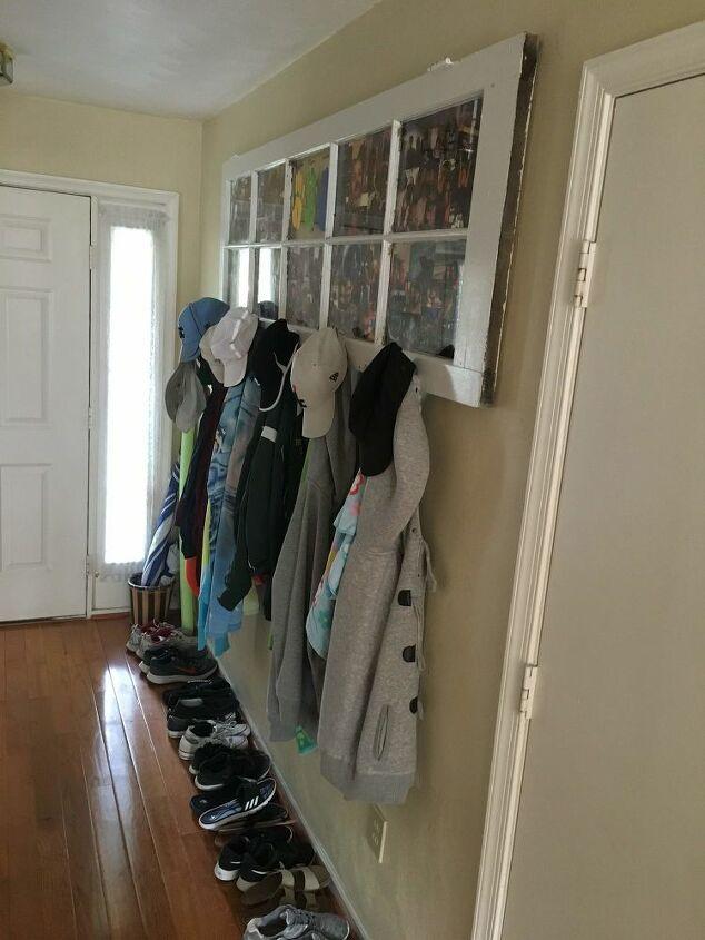 repurposed french door into wall mounted coat rack