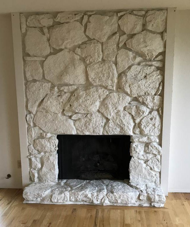 s 8 fireplace makeovers you have to see before winter, BEFORE This homeowner just wasn t feeling this stone fireplace