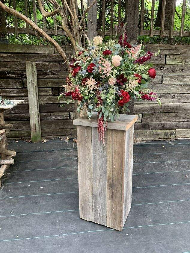 Beautiful flowers on rustic plant stand at Th