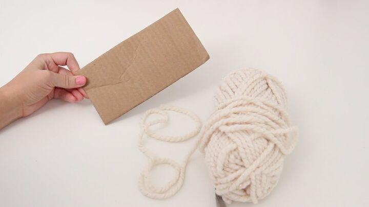 diy a cozy rug using pom poms