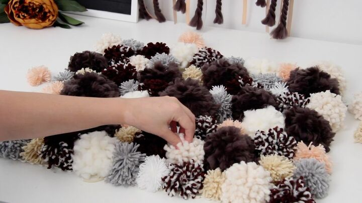 diy a cozy rug using pom poms