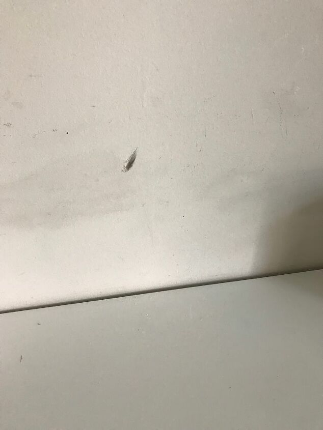 q how to repair this wood damage in my room wall