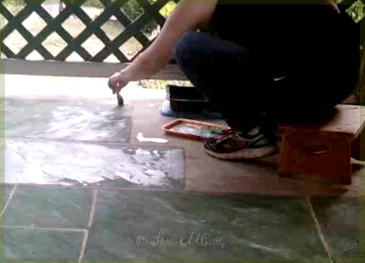 paint a concrete floor with faux marble tiles