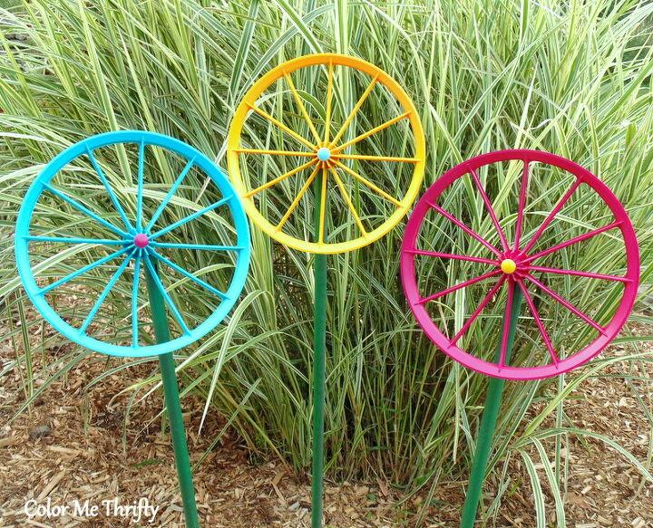 repurposed doll carriage wheel flowers