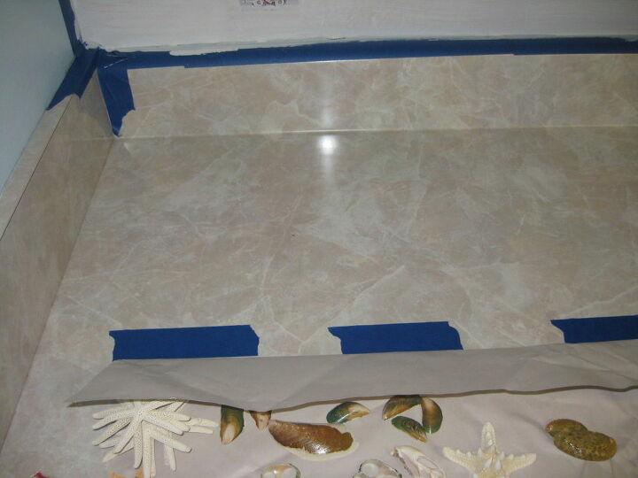 Tape marking backsplash height on counter.