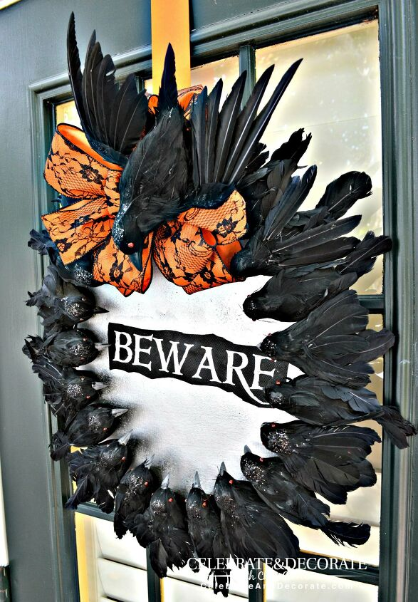 s 17 spooky halloween decor ideas that will scare your guests, Halloween wreath with creepy crows