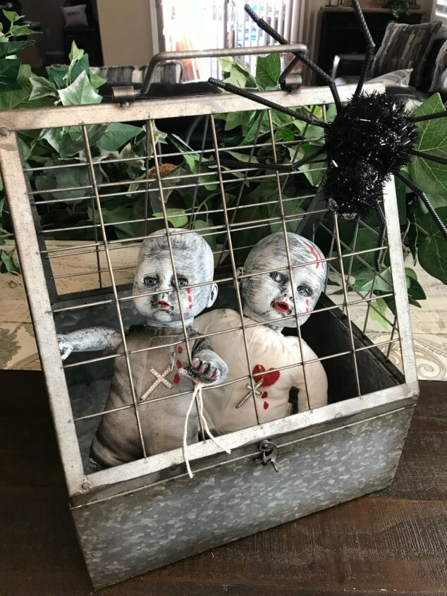 s 17 spooky halloween decor ideas that will scare your guests, Zombie babies