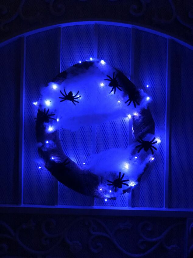 s 15 fun ways to get your porch front yard ready for halloween, Spooktacular fall wreath