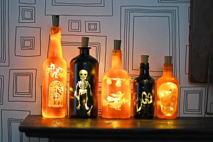 s 16 halloween decor ideas that ll be a huge hit at your party, Upcycled fun Halloween bottle lights