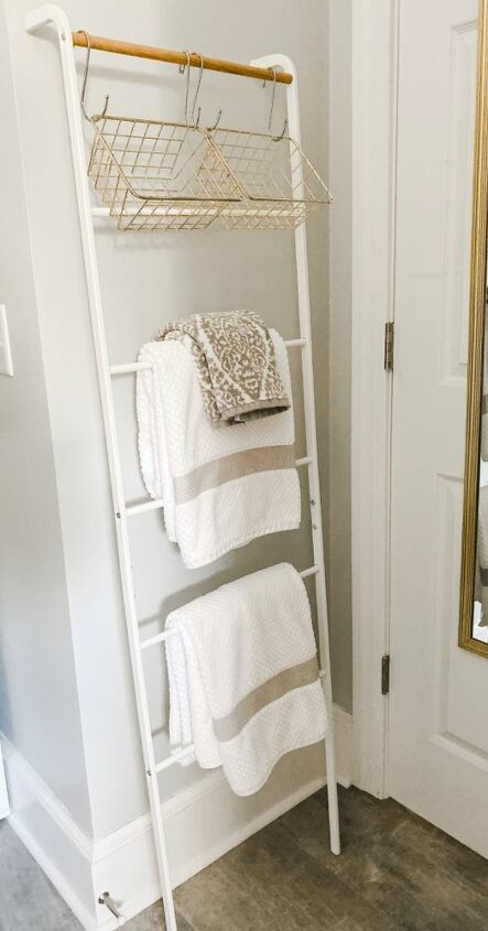 how i use a leaning towel rack and s hooks to sort laundry
