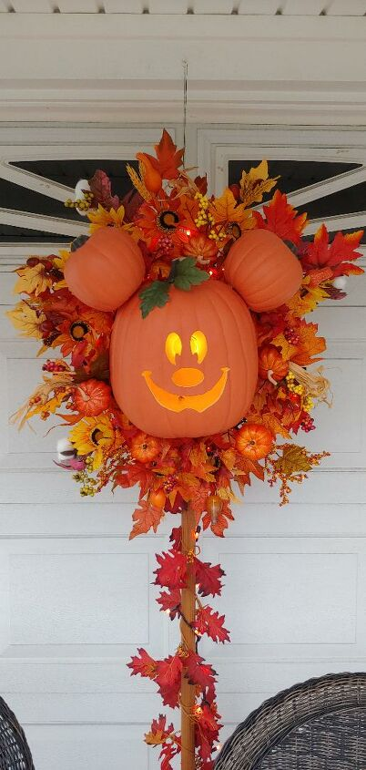 s 30 pumpkin projects for people that are totally obsessed with pumpkins, Mickey Mouse Halloween pumpkin wreath
