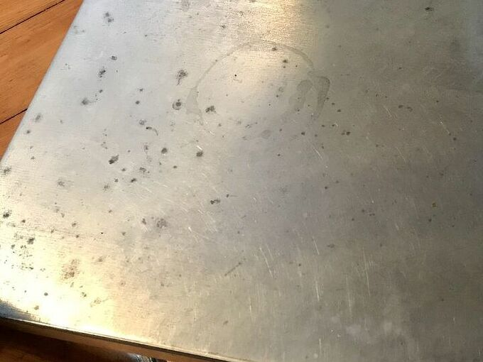 q how do i fix pitted stainless steel table