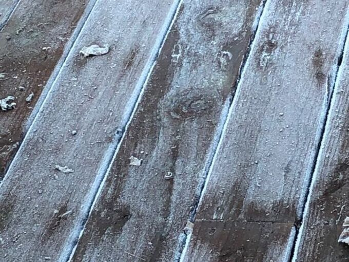 q wood deck is frosty and slippery what can i put to prevent slipping