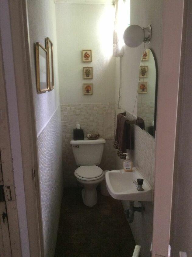 q how can i make this small narrow bathroom look bigger