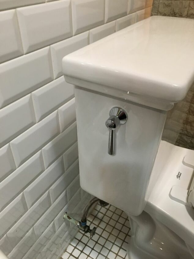 q three inch space between the wall and toilet tank
