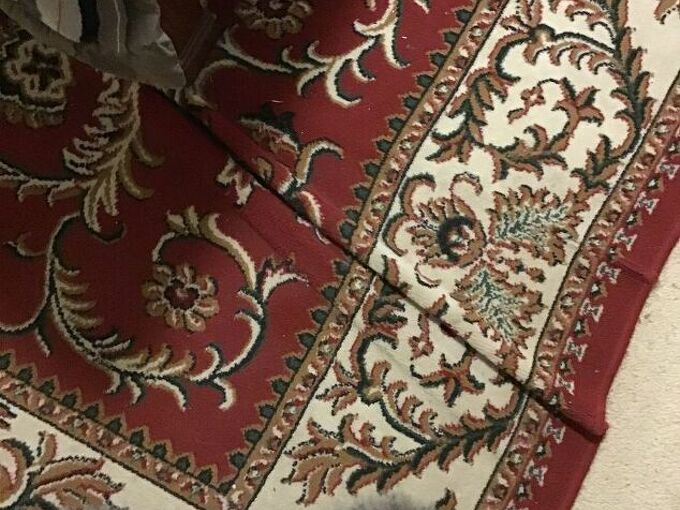 q how do i stop a rug that is under my bed from bunching up it is sit