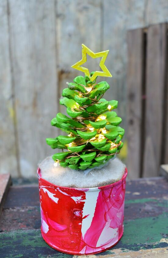 s 6 ways to use pine cones to decorate for the holidays, Cute illuminated pine cone Christmas trees
