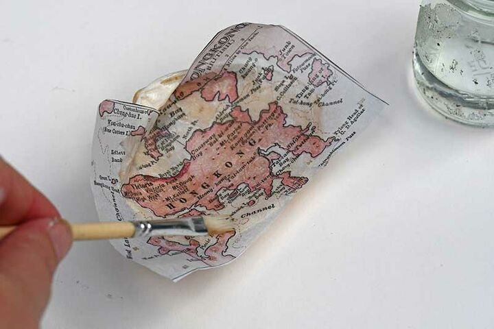 a coastal christmas gift with maps and shells