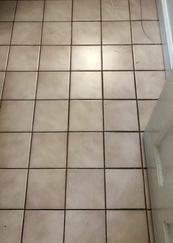 updating a bathroom floor with tile stickers