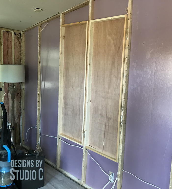 built in shelving between wall studs