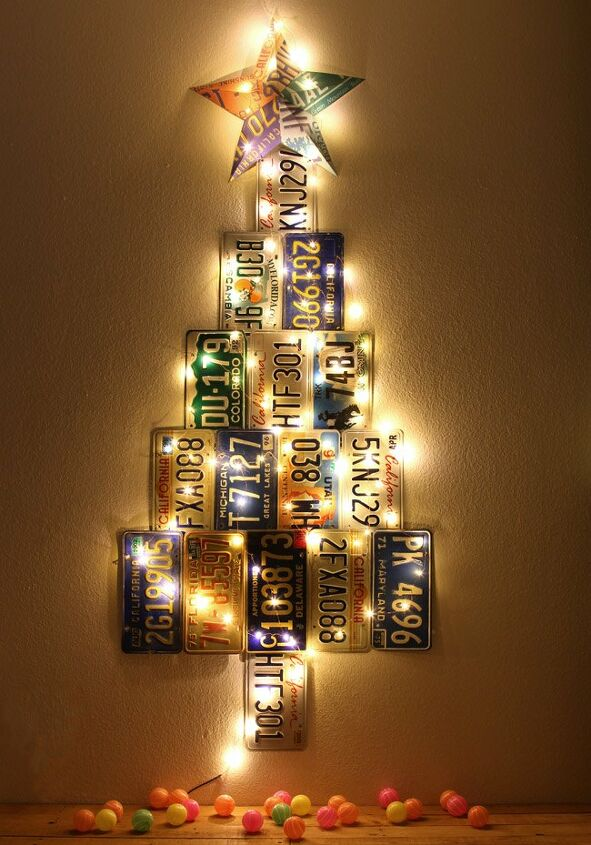 s 17 ways people are repurposing items to make christmas decor, A Christmas Tree Made From Old License Plates