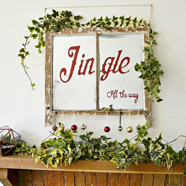 s 17 ways people are repurposing items to make christmas decor, Old Window Turned Into a Christmas Decoration