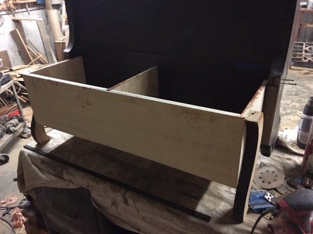 Seat box attached with from legs added.