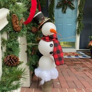 Turn giant ornaments into a snowman topiary!