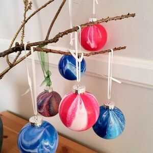 Pour paint over ornaments for a fun marbled effect!