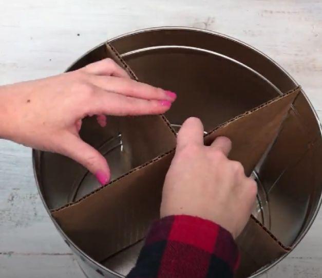 upcycle your popcorn tin into storage