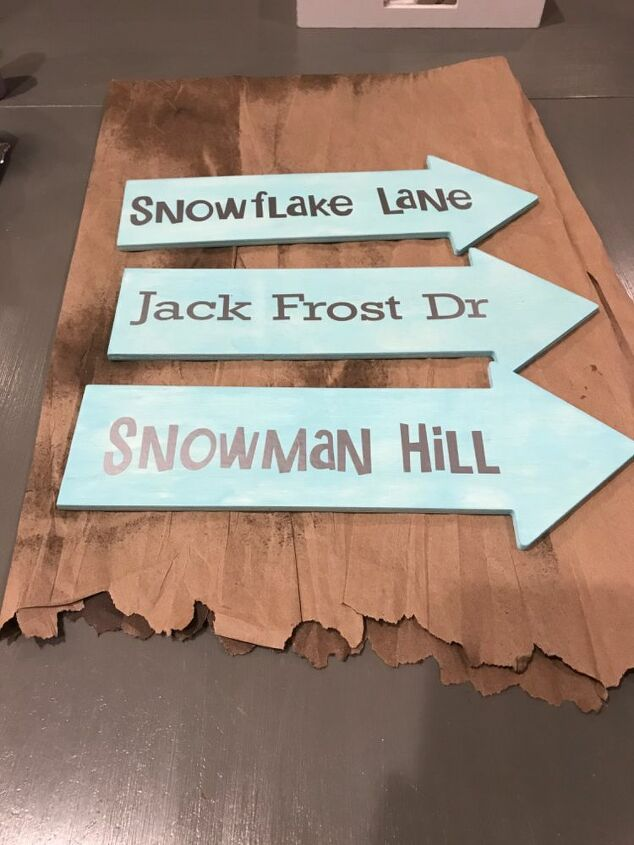 porch arrow sign winter themed
