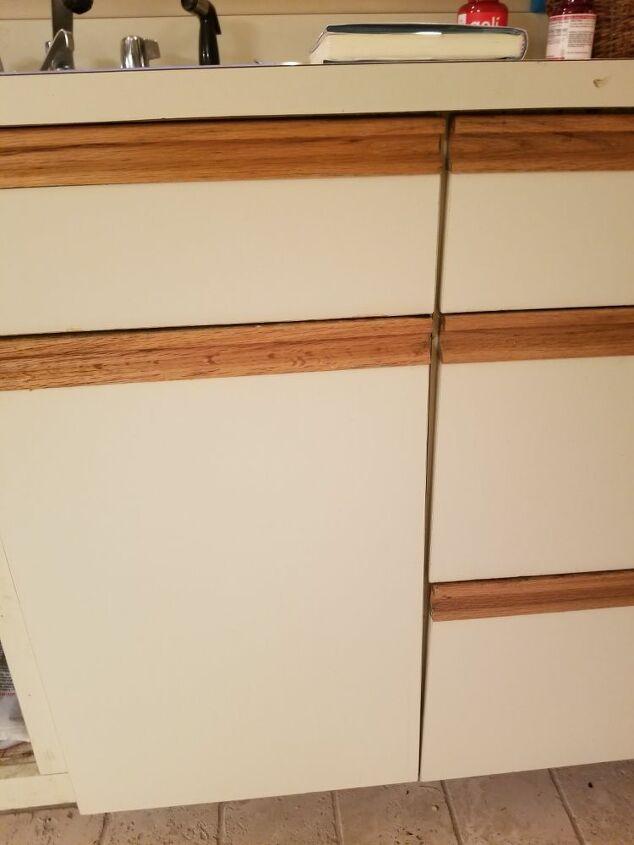 q fix a kitchen cabinet door