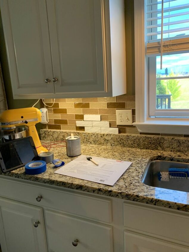 q painting glass tile