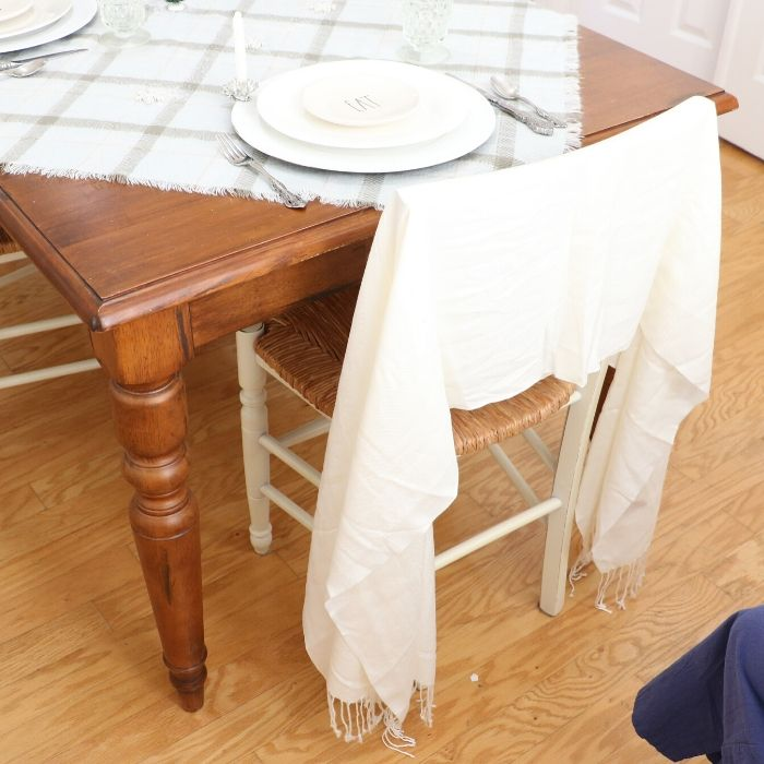 a simple way to tie a scarf on a chairback