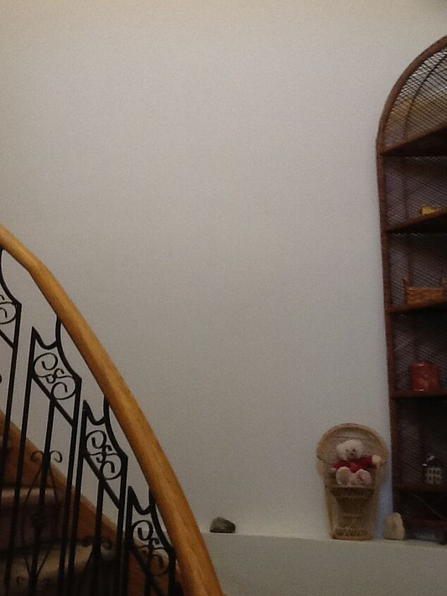 q how high up do you start hanging pictures on a stairway wall
