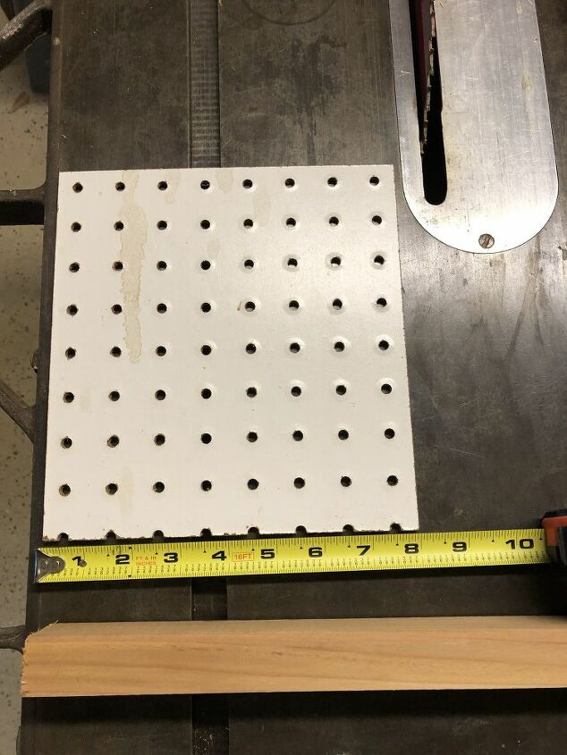 tips for accurately installing cabinet hardware, Scrap of pegboard for accurate hole drilling