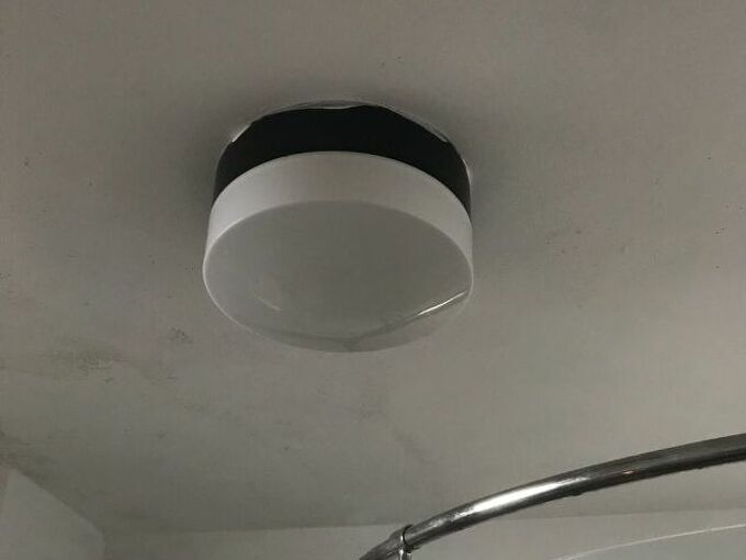 q how do i replace the bulb in this enclosed bathroom ceiling light